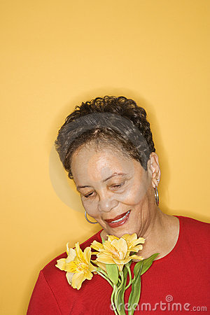 Free Woman Holding Flowers. Royalty Free Stock Photography - 2044807