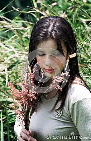 Woman Holding Flowers in Field