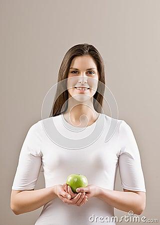 Woman holding fresh green apple