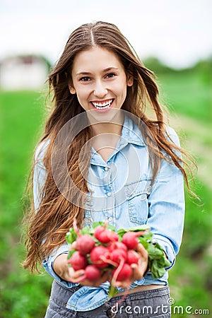 Woman Holding Fresh Radishes