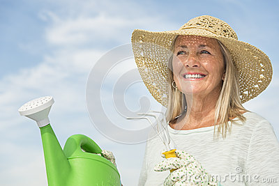 Woman Holding Gardening Equipment Against Sky