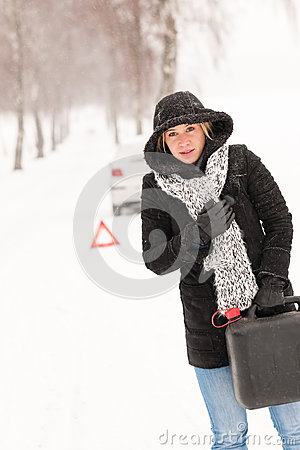 Woman holding gas can winter car breakdown