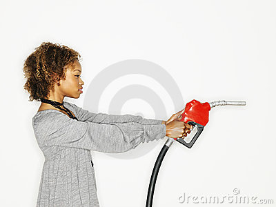 Woman holding gas gun