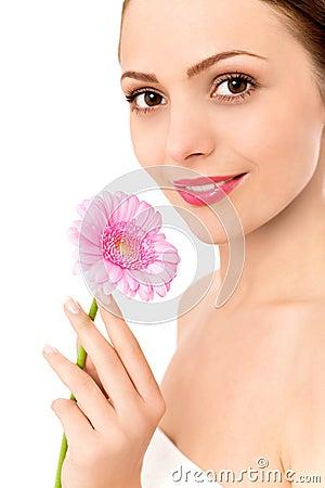 Woman holding gerbera daisy