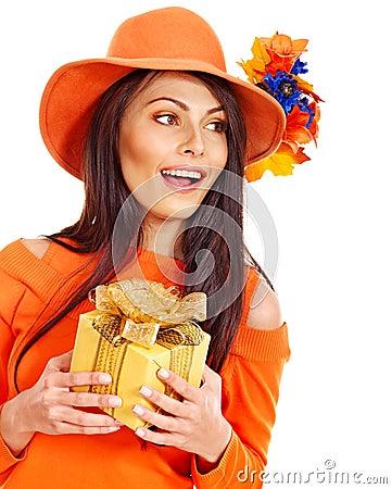 Woman holding gift box .