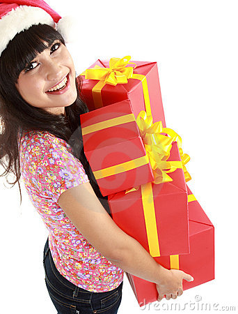 Woman holding gifts wearing Santa hat