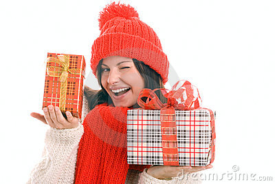 Woman holding gifts winking