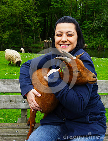Woman holding a goat