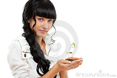 Woman holding green plant