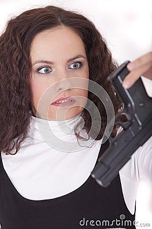 Woman holding gun in fear