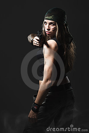 Woman holding gun with smoke