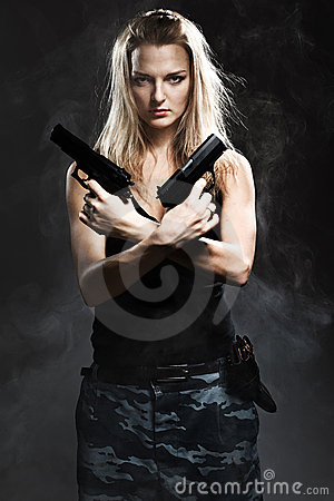 Free Woman Holding Gun With Smoke Royalty Free Stock Images - 23040409