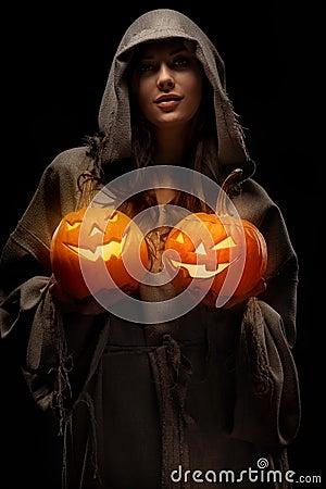 Woman holding halloween pumpkins