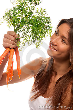 Woman holding in hand bunch fresh organic carrots