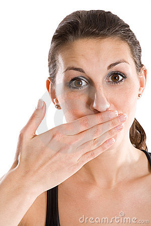 Woman holding hand over mouth