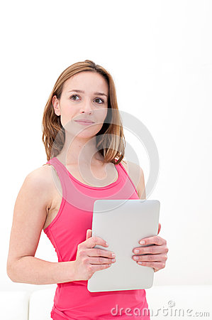 Woman holding in hand a tablet touch pad