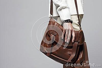 Woman holding handbag, focus on the handbag Stock Photo