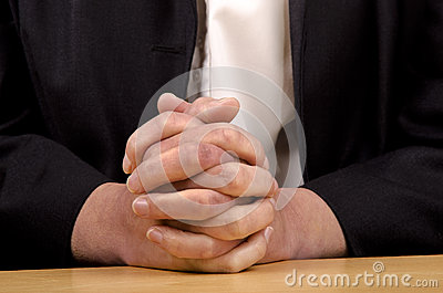 Woman holding hands folded for prayer