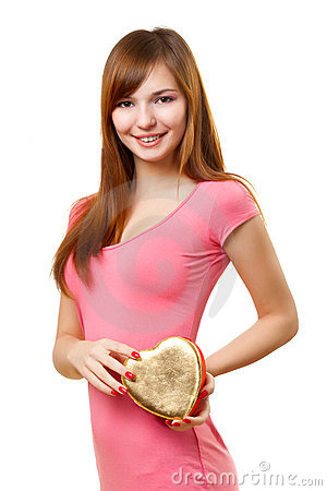 Woman holding heart shape box