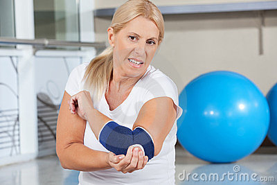 Woman holding her aching elbow