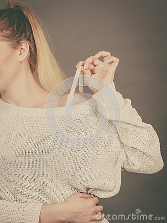 Free Woman Holding Her Bra Strap Stock Photo - 115322070