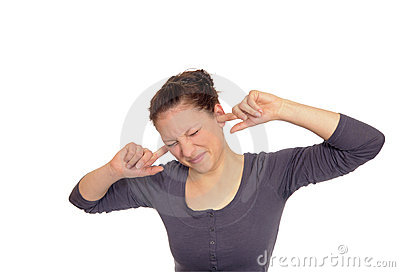 Woman holding her ears to