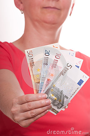 Woman is holding in her hand euro notes