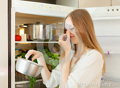 Woman  holding her nose because of bad smell