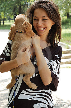 Woman holding her spaniel dog
