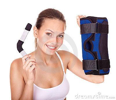 Woman holding hinged knee braces.