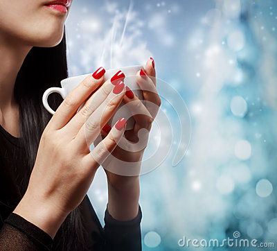 Woman Holding a Hot Beverage