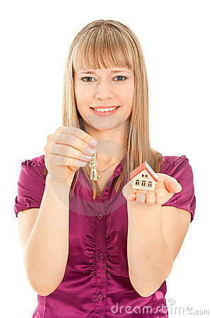 Woman  holding house and keys (focus on woman)