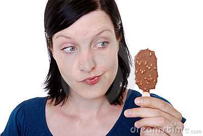 Woman holding ice cream bar