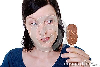 Woman holding ice cream bar