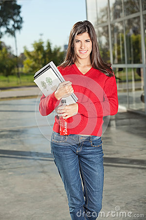 Woman Holding Juice Bottle And Books At University