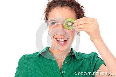 Woman holding kiwi