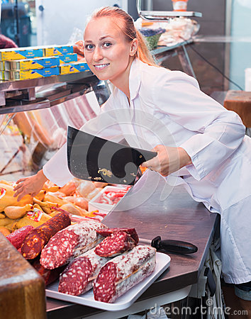 Free Woman Holding Knife In Meat Shop In Delicatessen Section Stock Images - 78637104