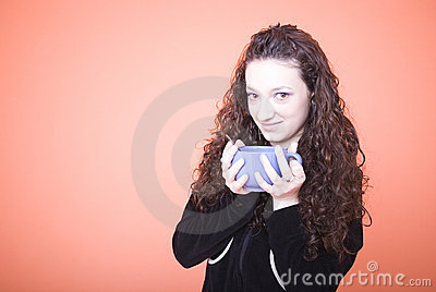 Woman holding large teacup