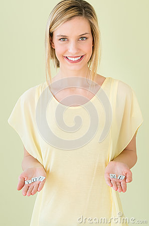Free Woman Holding Letter Blocks Reading You And Me In Palms Royalty Free Stock Photos - 32145908