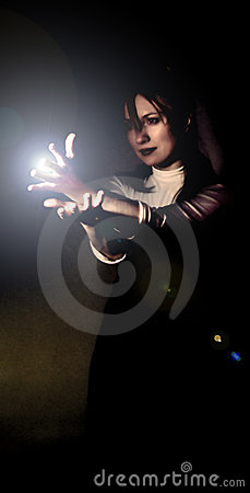 Woman holding light beam