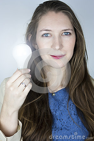 Woman holding lit light bulb