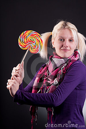 Woman holding lollypop
