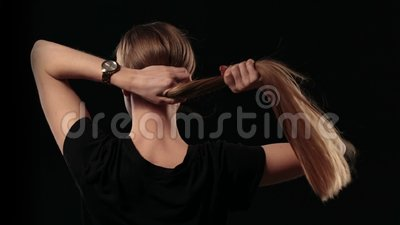 Woman holding long hair and pulling blond hair stock footage
