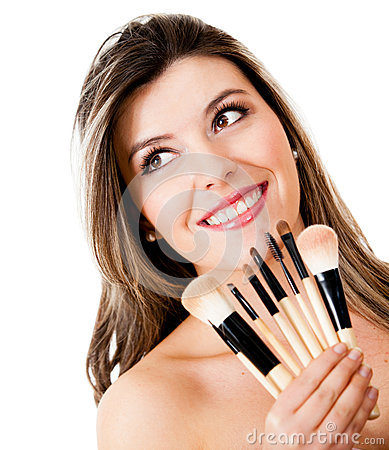Woman holding make up brushes