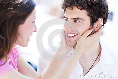 Woman holding man s face in her hands