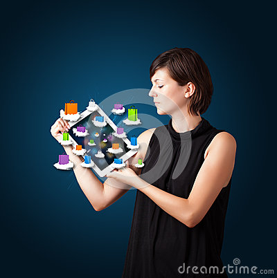 Woman holding modern tablet with colorful shopping bags on cloud