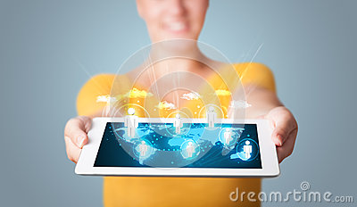 Woman holding modern tablet with social icons