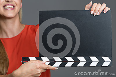 Woman with movie clapboard