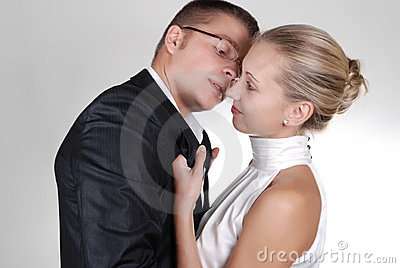 a woman holding a neckband of a man with passion