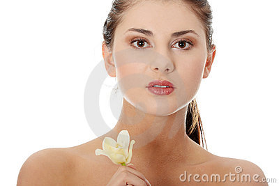 Woman holding orchid flower